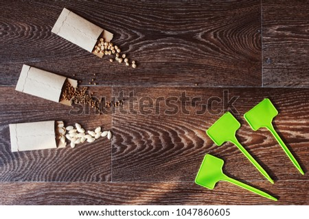 veggie seeds in craft paper envelope. Spring garden preparations for sowing seeds, organization and storage for safety. #1047860605