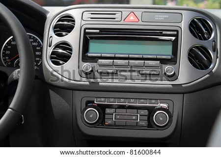 Vehicle instrument panel console and car stereo radio. - stock photo
