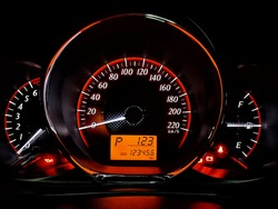 Vehicle miles 123456 kilometer.  Gear is in the parking position. Time is after 1 o'clock, 23 minutes.