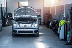 Vehicle repair shop with car and tools. Car service.