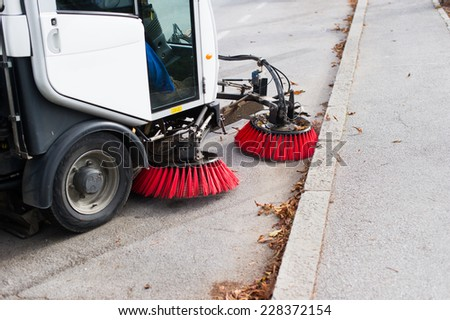 Vehicle sweeping the streets of dirt. #228372154