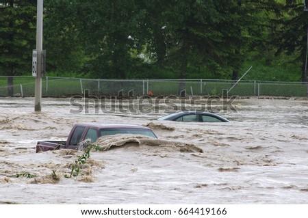 Vehicles submerged during flood #664419166