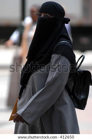 Veiled woman walking