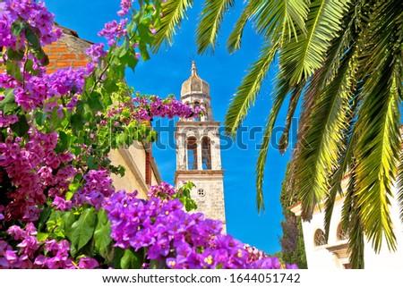 Vela Luka: Town of Vela Luka on Korcula island church tower and flowers view, archipelago of southern Dalmatia, Croatia Foto stock ©