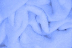Velvet. Plush. Pale Blue. (from the French peluche) - textiles with a short pile or nap, the same as fustian or velvet. Blue animal fur texture background, texture of plush fluffy fur close-up.