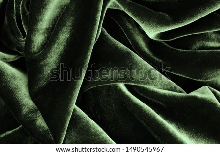 velvet texture green color background, expensive luxury fabric, material,  wallpaper. copy space Foto stock ©