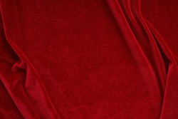 velvet texture red color background, expensive luxury fabric,  wallpaper. Christmas backdrop. copy space