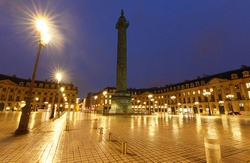 Vendome column with statue of Napoleon Bonaparte, on the Place Vendome at rainy night, Paris, France. Vendome column has 425 spiraling bas-relief bronze plates were made out of cannon.