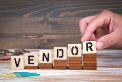 Vendor concept. Wooden letters on the office desk, informative and communication background