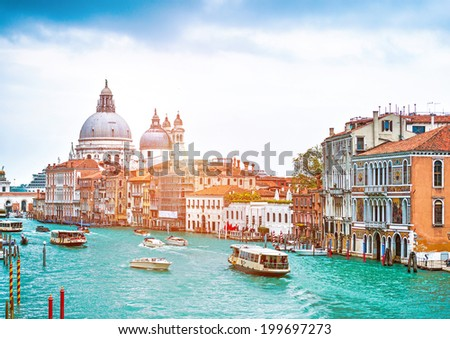 VENECIE, ITALY - APRIL 21: Canal Grande with Basilica di Santa Maria della Salute, on April, 21, 2014 in Venice, Italy #199697273