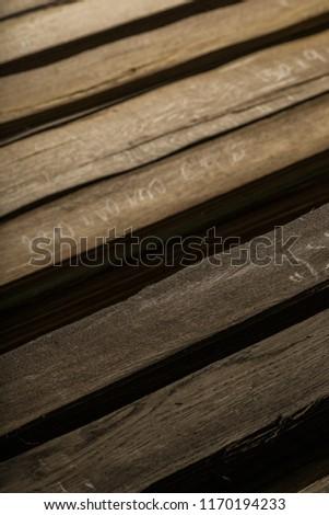 Veneered oak veneer folded into piles in the basement. #1170194233
