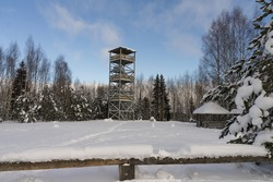 Venemae camping place in Korvemaa Nature park. Wooden watch tower. Protected rare environment. Winter background. Snowy pine branches. Typical in Estonia