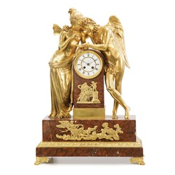 Venetian Accent Cupid and Psyche Gold and Marble Sculptural Clock Isolated. Decorative Golden Vintage Empire Style Decorative Time Pieces Statue for Living Room and Bedrooms. Retro Mantel Clock