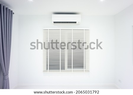 Venetian blind and air conditioner (ac) wall mount or indoor unit of split system consist of electric fan, filter and evaporator coil for climate, temperature and humidity control in room of home.