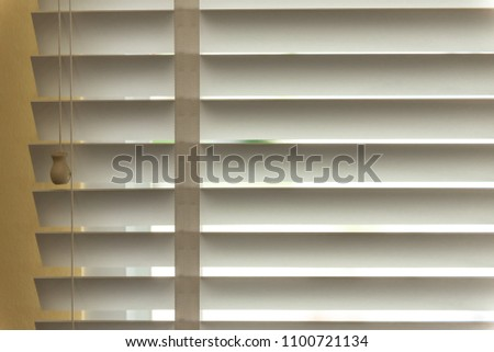 Venetian blinds by the window or blinds window, blinds window decoration concept. #1100721134
