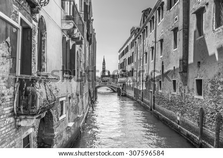 Venetian canal Rio de la Pleto. Old walls with balcony and architecturical elements. Venice, Veneto, Italy. Black and white photography.