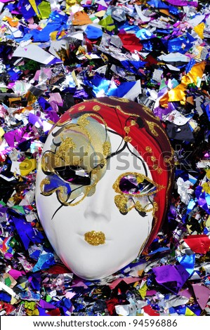 venetian carnival mask on a shiny confetti background