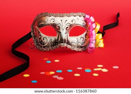 Venetian carnival mask on red