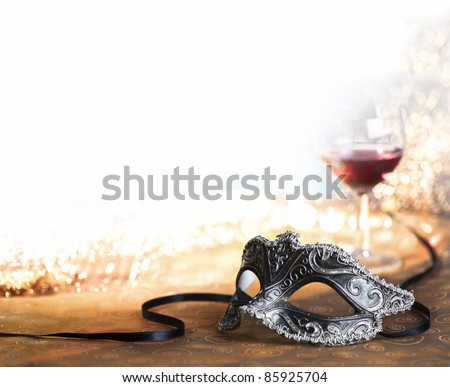 venetian carnival mask with wine