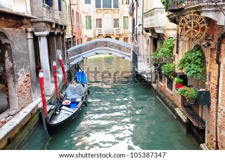 venetian gondola mooring in a quiet canal in Venice, Italy. #105387347