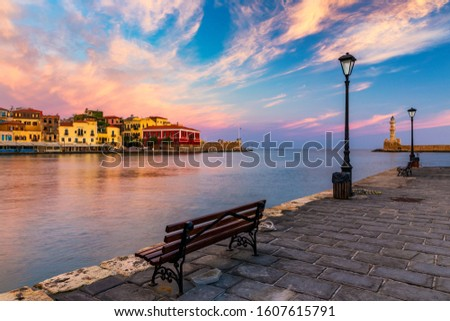 Venetian Harbour of the city of Chania at sunrise with turquoise water, Crete, Greece. View of the old port of Chania on Crete, Greece. Chania, Crete, Greece. View of the old port of Chania on Crete.
