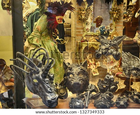 Venetian mask in a mask costume shops. Venice Italy #1327349333
