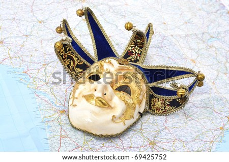 Venetian mask on a map