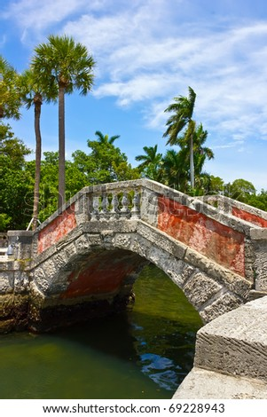 Venetian style bridge and palm trees at Vizcaya Museum & Garden in Miami, Florida