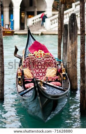 Venetian typical boat - gondola - in the harbor