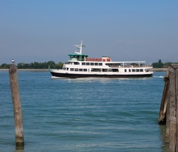 Venetian water bus also called VAPORETTO in Italy to transport tourists to Venice while mooring at the port with poles