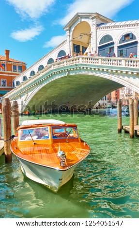 Venetian water taxi boat near Rialto bridge in Venice, Italy