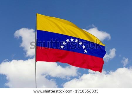 Venezuela flag isolated on the blue sky with clipping path. close up waving flag of Venezuela. flag symbols of Venezuela. Stockfoto ©
