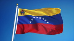 Venezuela flag waving against clean blue sky, close up, isolated with clipping path mask alpha channel transparency