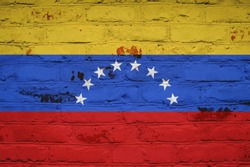 Venezuelan flag on brick wall background. Background wallpaper for installation and design. Space for text.
