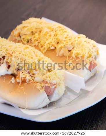 Venezuelan hot dog with cheese on top Foto stock ©