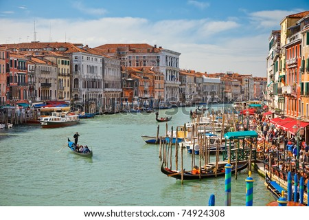 VENICE - APRIL 1, 2010: Tourists visit the Grand canal on April 1, 2010 in Venice, Italy . More than 20 million tourists come to Venice annually.