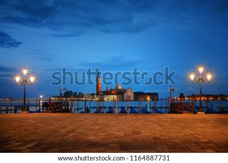 Venice at night with street lamp and San Giorgio Maggiore church in Italy.