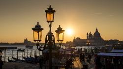 Venice at sunset, view from Molo over Canale Grande to Santa Maria della Salute