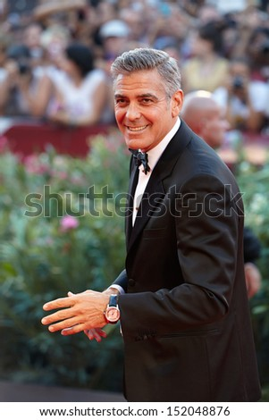 VENICE AUGUST 28 George Clooney greets fans as he arrives at the opening ceremony of the 70th Venice Film Festival on August 28 2013 in Venice
