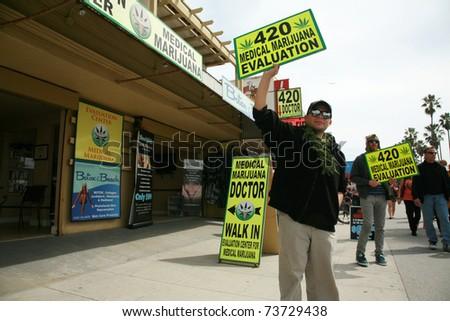 "VENICE BEACH, CA - MARCH 13: People hawk ""Medical Marijuana"" on the Venice Beach Board Walk on March 13, 2011 in Venice Beach, CA"