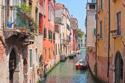 Venice Canal in summer with Gondola , Italy