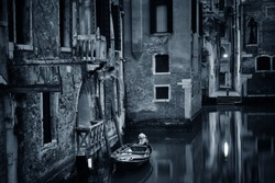 Venice canal view in early morning with boat historical buildings. Italy.