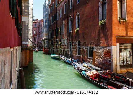 Venice canal with boats and gondolas Italy