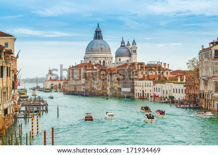 VENICE - DECEMBER 30:The Grand Canal in Venice with gondoliers rowing gondolas on December 30 2013.There are only 400 licensed Gondolas operating in Venice today.  #171934469