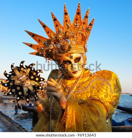 VENICE - FEBRUARY 21: An unidentified person in a carnival costume attends the end Carnival of Venice,  February 21, 2012 in Venice, Italy.