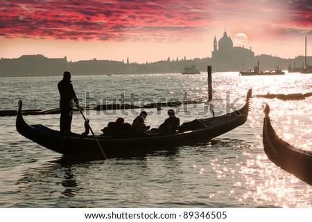 Venice, Gondola against colorful sunrise, Italy