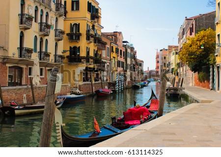 Venice gondola, Italy. Colorful buildings #613114325