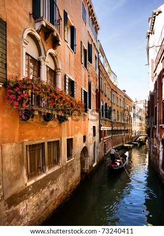 Venice, Gondola ride in a romantic small canal