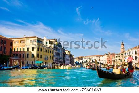 Venice Grand canal with gondolas and Rialto Bridge, Italy in summer bright day #75601063