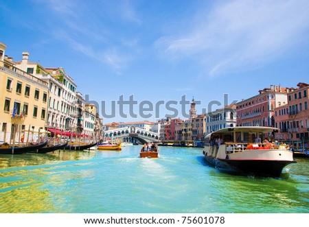 Venice Grand canal with gondolas and Rialto Bridge, Italy in summer bright day #75601078